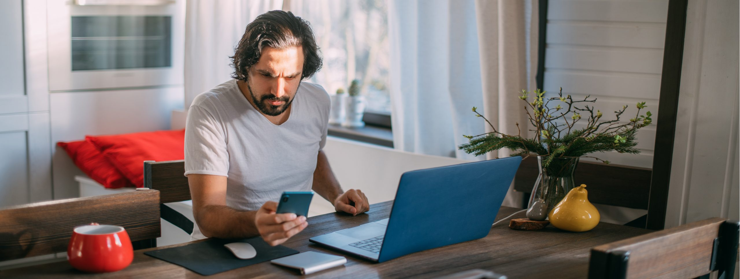 Workplace at home. A man works at a laptop at home